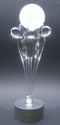 12a De samenwerking op handen dragen.  Met glazen bol. Op een zilvertinnen sokkel met asbestemming  € 243,00